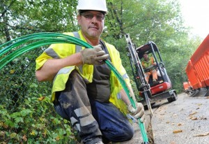 Virgin Media engineers lay cables in Papworth, Cambridgeshire
